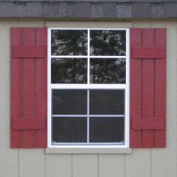 wooden garden sheds window with shutters